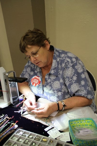 Nancy Davis, working intently on one of her handmade, one-of-a-kind bracelets.