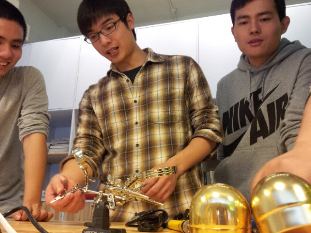 Members help set up tools for a DIY workshop at the grand opening of the ChaiHuo makerspace in Shenzhen.