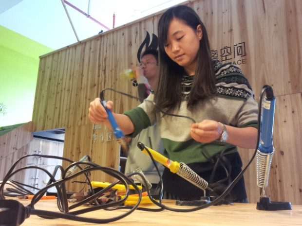 Volunteers help set up soldering stations for a workshop at the ChaiHuo makerspace in Shenzhen.