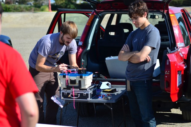 John Boiles and Mason Glidden fine-tune the APRS tracking circuitry.