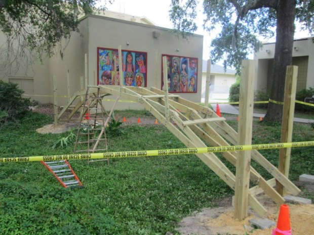 """With the help of the school's maintenance crew, they set and cemented in four posts that the bridge would be bolted to with 4"""" lag bolts."""