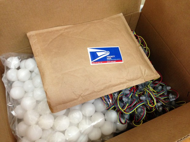 The team gets the materials in the mail -- about 400 LEDs and a lot of ping pong balls!