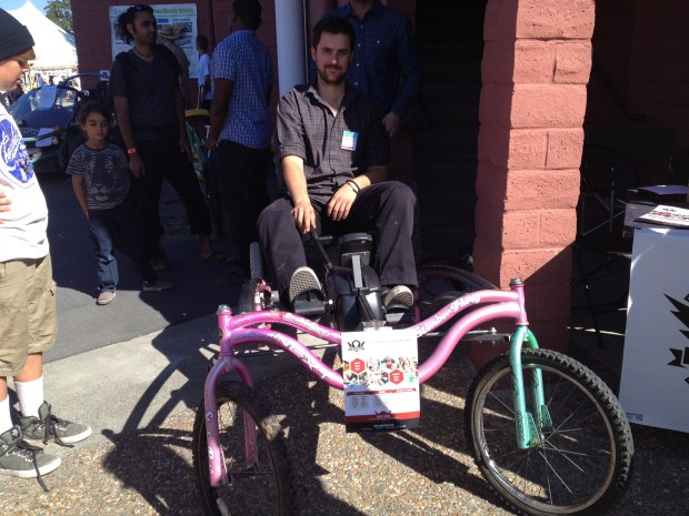 Dana Woodman, founder of Chimera Makerspace, showing off their pedal car.