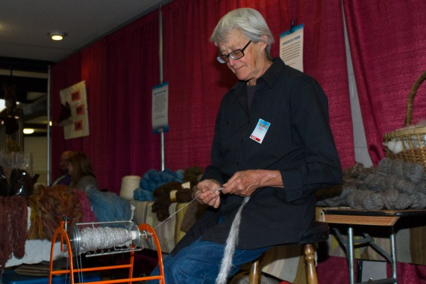 Windrush Farms' raw wool of alpacas and sheep. Here Mimi luebbermann is using a modern spinner, turning wool into yarn.