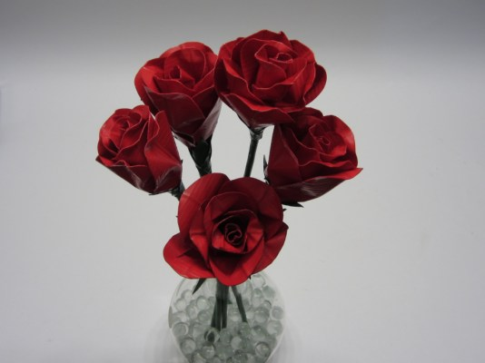 Buying a dozen roses isn't particularly original. But making them out of duct tape is.