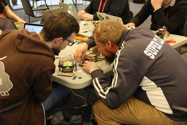 "Paweł Szymczykowski led the ""Build a Bot"" workshop by teaching attendees to build one of his SumoBot Jr kits."