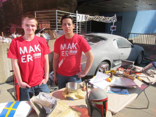 "Koji Allen (right) and intern showed and worked on his DIY SuperCar.  Watch for Koji's forthcoming book, ""The Working Man's Guide to Auto Design.""  http://on.fb.me/Q9lZnV"