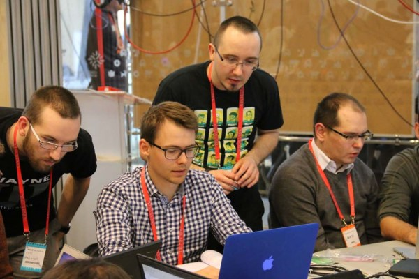 "Wojtek Siudzinski and Matt Kozak assist Makerland attendees at the ""Python and Ruby Sitting in a Tree"" workshop."