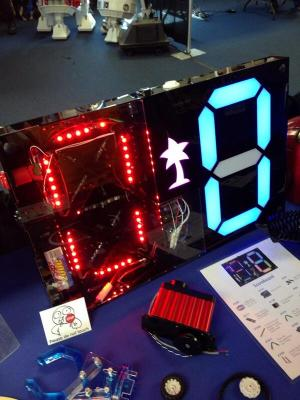 Las Vegas Mini Maker Faire sponsor Pololu built this seven segment RGB LED scoreboard to keep score for office competitions.