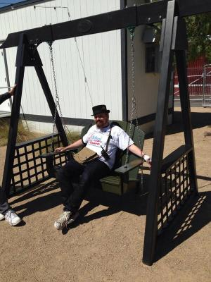 Las Vegas Mini Maker Faire organizer, Paweł Szymczykowski takes a quick break by testing out a swing by Las Vegas Swings.