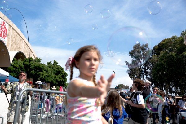 Chasing bubbles outside Expo Hall.