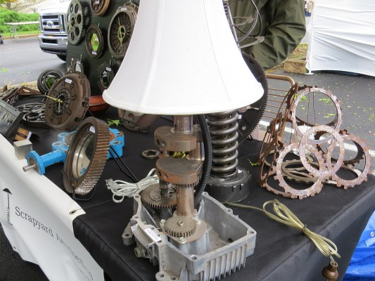 Scott from Scrap Yard Aesthetics made this cool lamp from engine parts. The gear at the lower right is the on/off switch. http://www.scrapyardaeesthetics.com