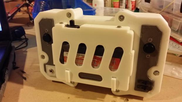 A view of the battery cover, held in place by two screws.