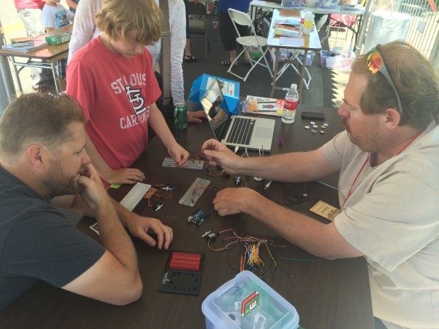 Dennis teaches breadboarding at the STEAM tent.