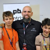 Sam Schickler at Maker Faire Bay Area 2014 with Printrbot's Brooke Drumm and fellow Maker Club student Alexander. Via Tales of a 3D Printer