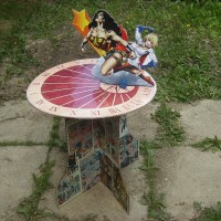 A simple cardboard Wonder Woman/Powergirl sundial design