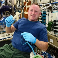 "ISS Commander Barry ""Butch"" Wilmore holds up the ratcheting socket wrench on the space station right after it was 3D-printed it (Credit: NASA)."