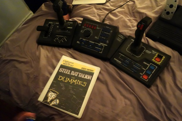 The second-gen controller and the manual David made to instruct rookie players on how to operate the mecha.