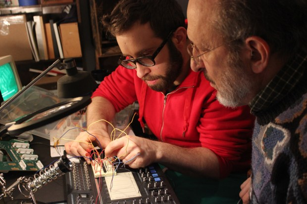 The maker - and his dad! - testing for unwanted event triggers with a breadboard circuit.