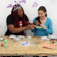 Girls using a blink blink circuit kit.