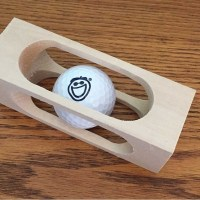 Golf-Ball-inside-a-block-of-wood-2
