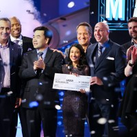 Team Grush Brush celebrate winning America's Greatest Makers. Front row (from left) Brian Krzanich Intel CEO and show judge; Yongjing Wang, Team Grush; Dr. Anubha Sacheti, Team Grush; Ethan Schur, Team Grush; Carol Roth, show judge. Back row (from left) Kenny Smith, guest judge; Mike Rowe, guest judge; Jonathan Schaffer, Team ASEAH. (Credit: Tommy Baynard/Intel Corporation)