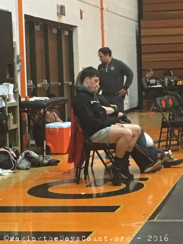 W looks on and waits for his next match. I snapped this and texted it to him and got the reply 'go get me a sub' followed by 'thank you.'