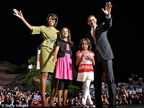 Barack Obama with his wife & 2 daughters