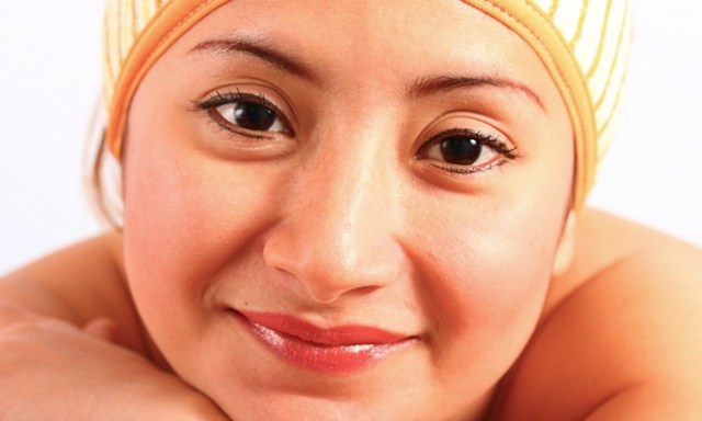 Relaxed Girl With Moisturized Skin Wearing A Headband
