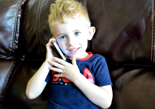 Aidan on the smartphone back to school