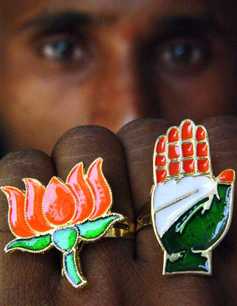INDIAN SHOPKEEPER DISPLAYS RINGS WITH POLL SYMBOLS OF INDIA'S RULING BJP AND MAIN OPPOSITION CONGRESS ...
