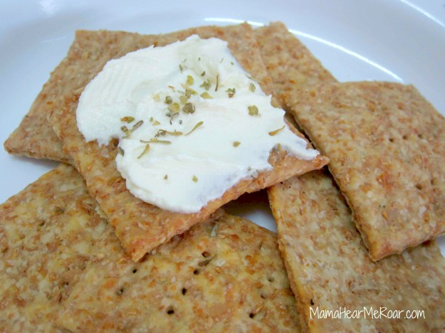 Wholewheat thins topped with yogurt cheese. These can be addictive!