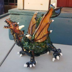 Dragon. Contact Kris @ 719-231-9214
