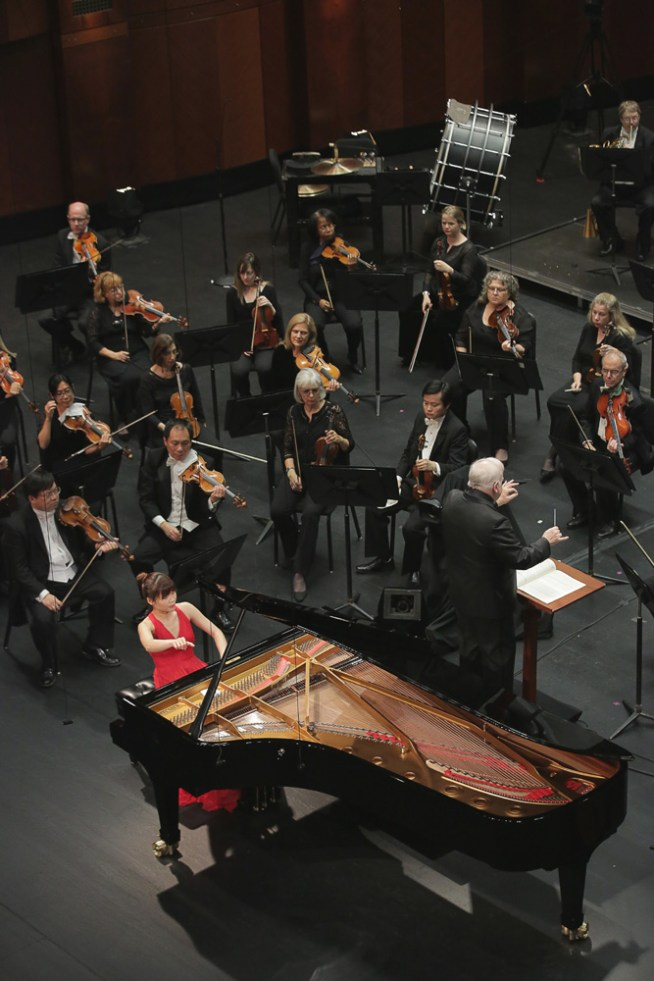 June 10, 2017.  Rachel Cheung from Hong Kong performs with conductor Leonard Slatkin and the Fort Worth Symphony Orchestra on Saturday in the Final Round of The Fifteenth Van Cliburn International Piano Competition held at Bass Performance Hall in Fort Worth, Texas.  (Photo Carolyn Cruz)