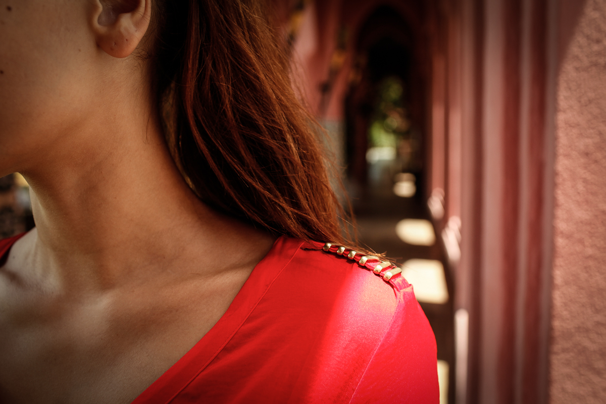 golden details on a red satin blouse