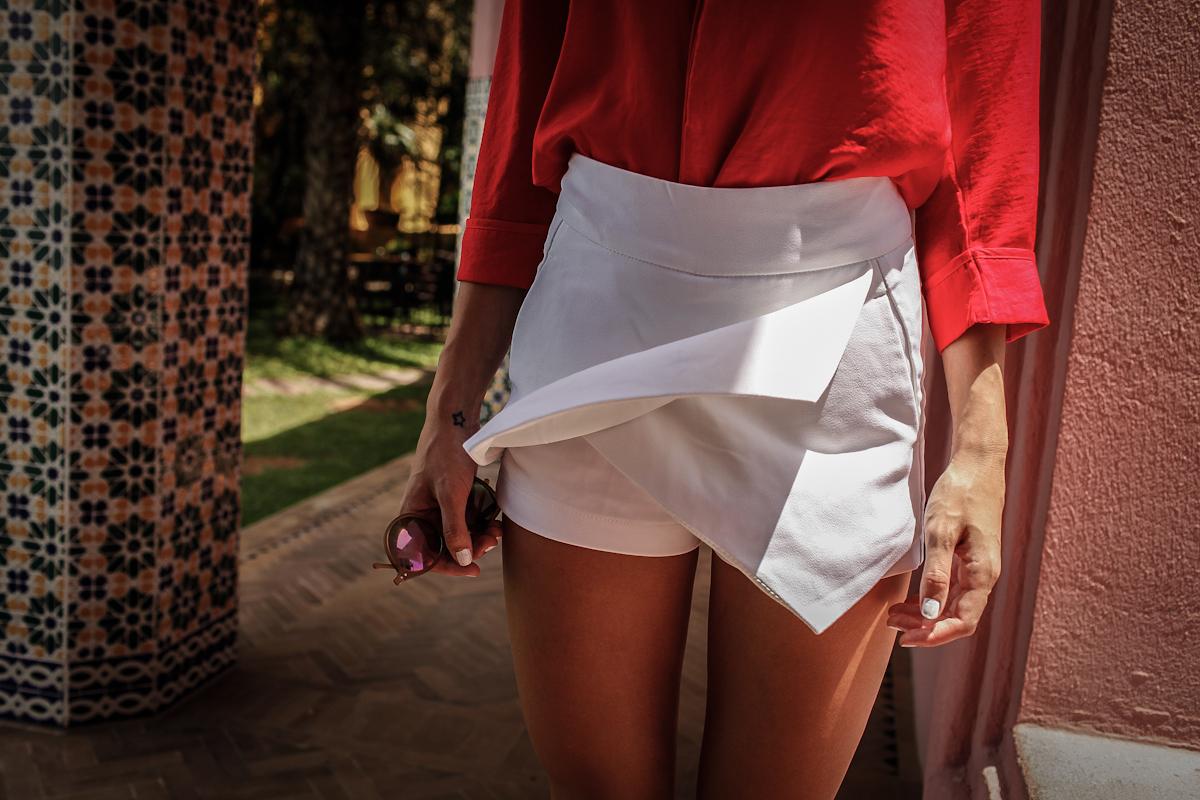 girl wearing white skirt from zara. girl wearing a red blouse