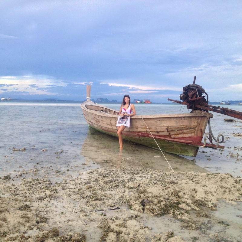 girl and boat on koh kradan island beautiful background