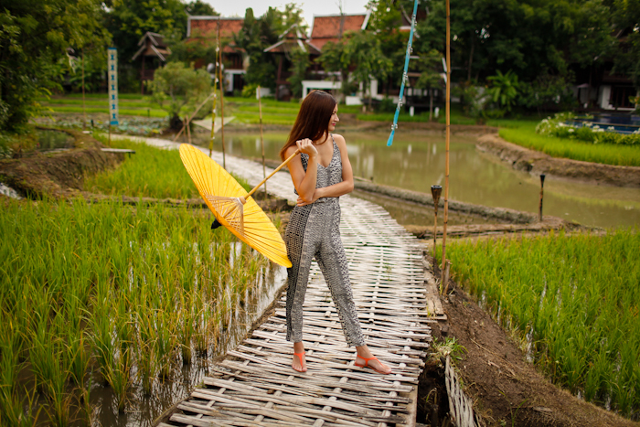 girl staniding with umbrella on rice fields of dhara dhevi