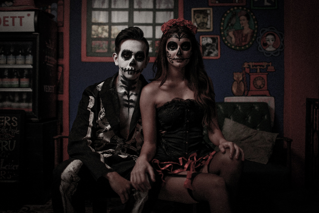 couple wearing day of the dead make up and costumes