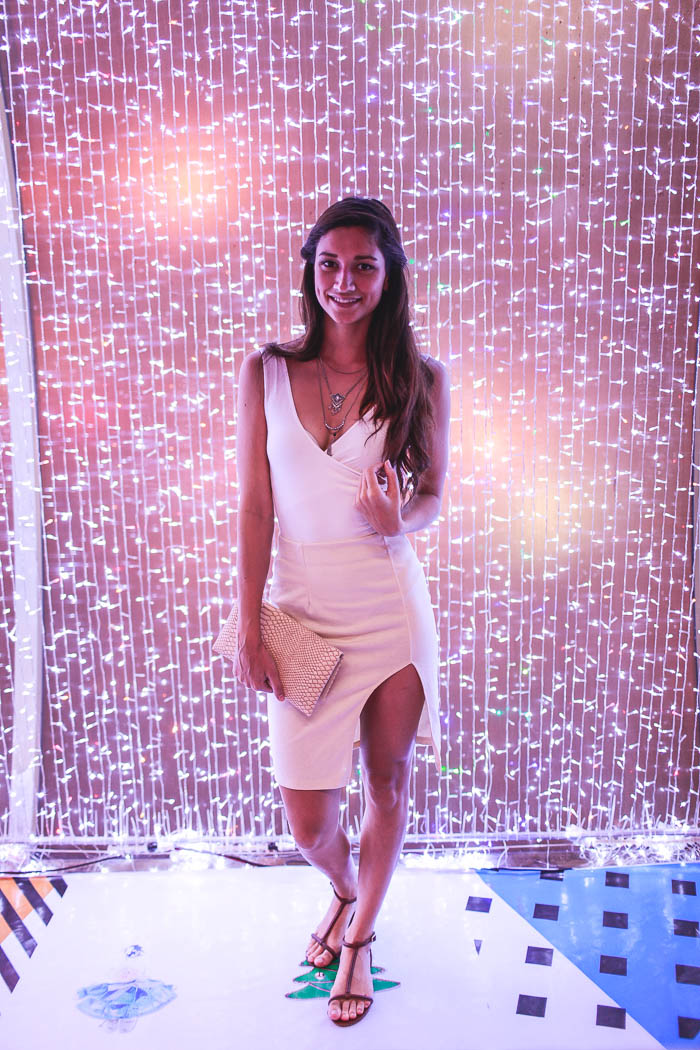 girl standing in christmas lights