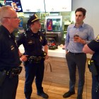 Michael Gamache, third from left, chats with, from left, Capt. Todd Boucher, Lt. Brian O'Keefe and Chief Nick Willard during a June Coffee with a Cop event at his Second Street McDonald's restaurant.