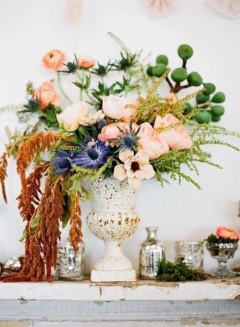 Those pale pinks, peaches, and greens with that rust and bright blue?  Can't resist this palette.