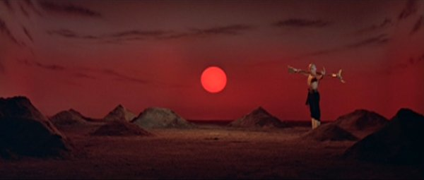Gordon Liu strikes a kung-fu post with a red sunset in the background.