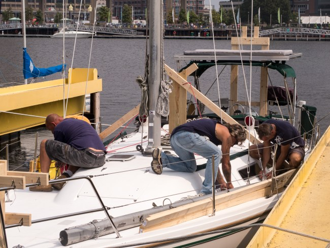 Removing the shrouds which help support the mast.
