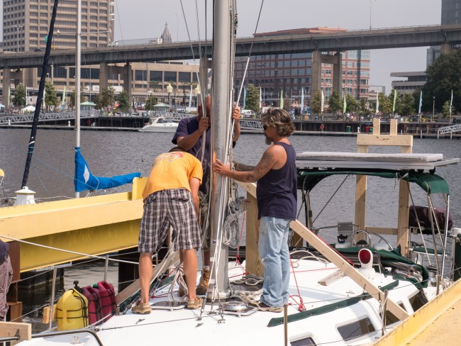 Ron and the marina crew lashing the shrouds to the mast before it's lifted.