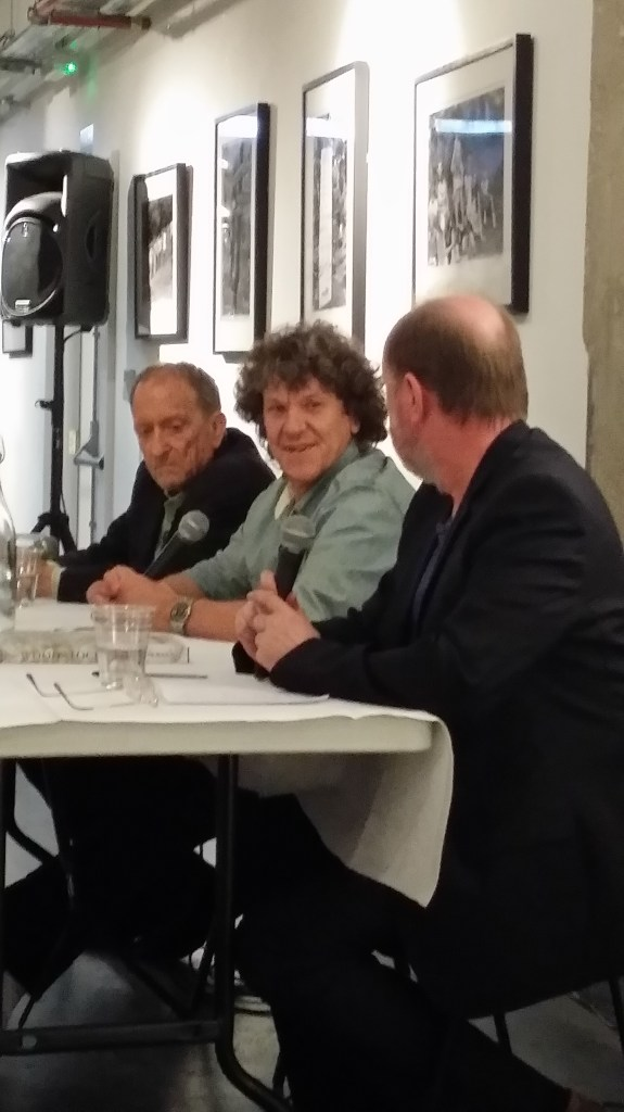Michael Lang (centre) and Baron Wolman talking Woodstock to Peter Doggett
