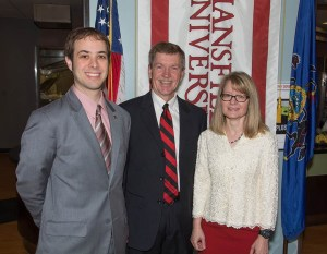 Guest speaker Jamie Hall '03 with Graduation Celebration hosts, Professors Lee and Kathy Wright '82.