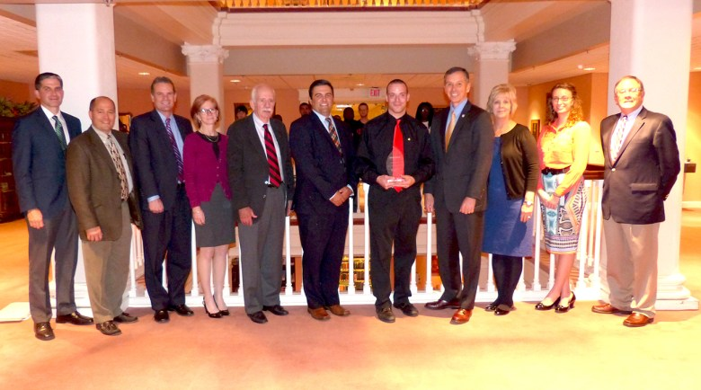 James Querry (center) with Anthony Montemurro of Fresenius Kabi (immediate left), MU President Fran Hendricks (immediate right) and members of the MU Council of Trustees.