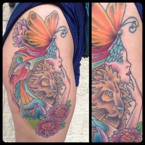 Thigh tattoo by Geno.