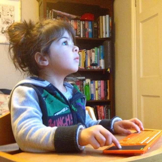 Girl coding using a Kano computer for kids